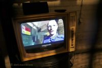 10-Z - 02 - screens inside old TV sets playing explanatory videos
