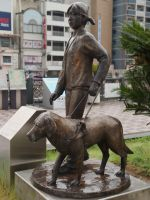Nagasaki 32 - wet guide dog monument outside the station