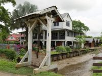 Suriname 26 - sluice gate, drainage canal and restored plantation house