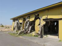 Fukushima 33 - bent-out concrete walls demonstrate the power of the tsunami